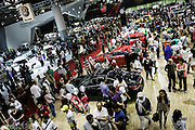 JAKARTA - INDONESIA; SUNDAY, SEPTEMBER 21, 2014; INDONESIA ECONOMIC RISING: People attend a motor show in Jakarta, Indonesia on Sunday, September 21, 2014. According to Asian Development Bank's 2014 report, Indonesia economy growth potential is in creative industry after for years relies heavily on natural resources such as mineral mining and palm oil. By the presidency of Joko Widodo, as a product of the third people election after the People Power Revolution in 1998, Indonesia is more confident in the economy growth and optimistic to become equal in quality to Brazil and China's economy growth. The emerging of Indonesia economy for the last one and a half decade after the end of Suharto's Dictatorship has been in significant way, the per capita growth has reached 400% under Susilo Bambang Yudhoyono presidency. Indonesia is home for 74 million of middle class as estimated by Boston Consulting Group, and  will double in 2020.