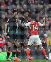 Football - 2016 / 2017 Premier League - Arsenal vs. Hull City<br /> Harry McGuire and Tom Huddlestone of Hull tangle with Theo Walcott of Arsenal at The Emirates.<br /> <br /> COLORSPORT/ANDREW COWIE