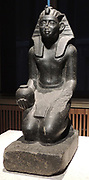 Kneeling figure of Sobekhotep V with ointment vessels 13/14 dynasty around 1750-1700 BC Granite.