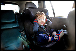 A young boy in a Child Seat in a 4x4 car in London, United Kingdom. Saturday, 1st February 2014. Picture by Andrew Parsons / i-Images