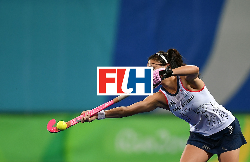 Britain's Sam Quek hits the ball during the women's quarterfinal field hockey Britain vs Spain match of the Rio 2016 Olympics Games at the Olympic Hockey Centre in Rio de Janeiro on August 15, 2016. / AFP / MANAN VATSYAYANA        (Photo credit should read MANAN VATSYAYANA/AFP/Getty Images)