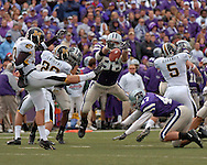 Kansas State's Ian Campbell (98) blocks Missouri punter Adam Crossett's punt in the first quarter.  The Wildcats returned the blocked punt for a touchdown, to K-State a 14-7 lead at Bill Snyder Family Stadium in Manhattan, Kansas, November 19, 2005.  K-State defeated the Missouri Tigers 36-28.