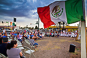 July 22 - PHOENIX, AZ: About 50 people gathered on a street corner in a Hispanic neighborhood in Phoenix, AZ, Thursday night to pray the rosary. They are members of a Catholic community that opposes Arizona's tough new immigration law, SB 1070, which requires local police officers to check the immigration status of people they suspect of being in the US illegally and requires legal immigrants in Arizona to carry their immigration documents with them at all times. Photo by Jack Kurtz