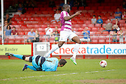Barnet FC Striker John Akinde (9) takes it past Crawley Town Goalkeeper Paul Jones (1) during the Sky Bet League 2 match between Crawley Town and Barnet at the Checkatrade.com Stadium, Crawley, England on 7 May 2016. Photo by Andy Walter.