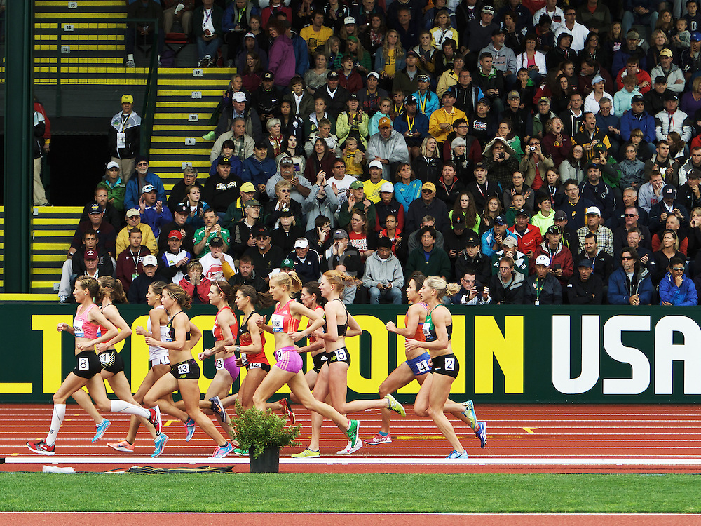 pack of 5000 meter runners in front of East Grandstand, TrackTownUSA