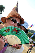 A woman with pointed hat and fan, Workhouse Festival, Wales 2006