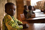 A boy sits in a classroom at the Alandohou primary school in the village of Alandohou, Benin on Monday September 10, 2007.
