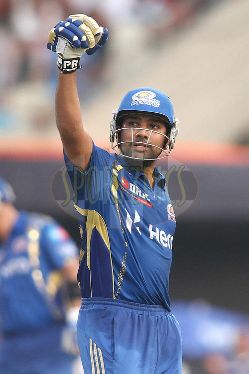 Rohit Sharma of the Mumbai Indians celebrates after reaching his hundred during match 58 of the the Indian Premier League (IPL) 2012  between The Kolkata Knight Riders and The Mumbai Indians held at the Eden Gardens Stadium in Kolkata on the 12th May 2012..Photo by Shaun Roy/IPL/SPORTZPICS
