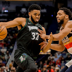 Dec 31, 2018; New Orleans, LA, USA; Minnesota Timberwolves center Karl-Anthony Towns (32) drives past New Orleans Pelicans center Jahlil Okafor (8) during the first quarter at the Smoothie King Center. Mandatory Credit: Derick E. Hingle-USA TODAY Sports