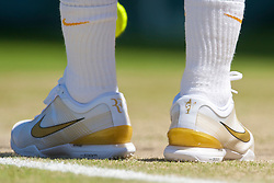 LONDON, ENGLAND - Wednesday, July 1, 2009: The gold Nike boots of Roger Federer (SUI) featuring his initials and five Wimbledon Championship trophy logo during the Gentlemen's Singles Quarterfinal on day nine of the Wimbledon Lawn Tennis Championships at the All England Lawn Tennis and Croquet Club. (Pic by David Rawcliffe/Propaganda)