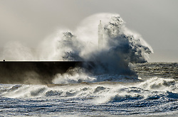 © London News Pictures. 08/12/2017. Aberystwyth, UK.<br /> The southern edge of Storm Caroline, with winds gusting between 40 and 60 mph, is still impacting on the harbour lighthouse  sea defences  in Aberystwyth, Ceredigion , west Wales UK. Photo credit: Keith Morris/LNP