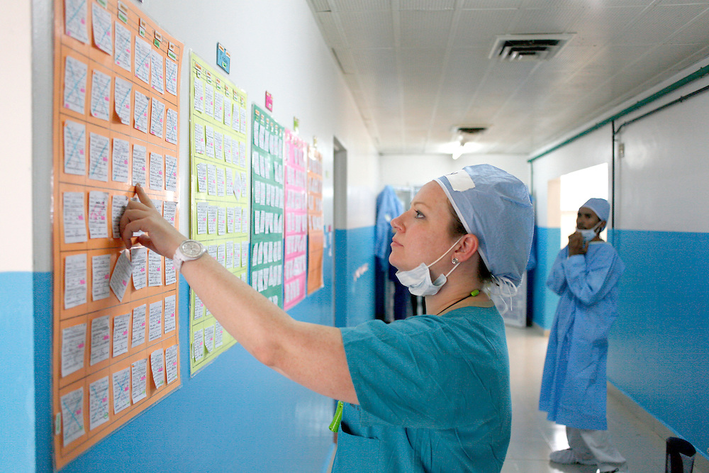 Child Life specialist Joy Daugherty looks at the surgery schedule in the OR...Operation Smile South Africa.Operation Smile Mission to Hospital Joseph Ravoanangy Andrianavalona,.Antananarivo, Madagascar. September 17th - 29th 2011..© Operation Smile Photo / Zute & Demelza Lightfoot.www.lightfootphoto.com