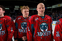KELOWNA, CANADA - MARCH 16: Ted Brennan #10 and Dallon Wilton #15 of the Kelowna Rockets line up for the shirt off your back presentation after the OT win against the Vancouver Giants  on March 16, 2019 at Prospera Place in Kelowna, British Columbia, Canada.  (Photo by Marissa Baecker/Shoot the Breeze)