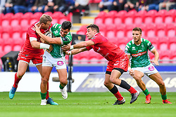 Marco Zanon of Benetton Treviso is tackled by Hadleigh Parkes of Scarlets<br /> <br /> Photographer Craig Thomas/Replay Images<br /> <br /> Guinness PRO14 Round 3 - Scarlets v Benetton Treviso - Saturday 15th September 2018 - Parc Y Scarlets - Llanelli<br /> <br /> World Copyright © Replay Images . All rights reserved. info@replayimages.co.uk - http://replayimages.co.uk