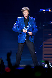 © Licensed to London News Pictures . 18/05/2014 . Phones4U Arena, Manchester , UK . Barry undoes his jacket button . Barry Manilow performs at the Phones4U Arena in Manchester . Photo credit : Joel Goodman/LNP