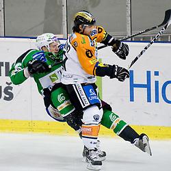 Christoph Harand  (Moser Medical Graz 99ers, #61) hit Bostjan Groznik (HDD Tilia Olimpija, #6) during ice-hockey match between HDD Tilia Olimpija and Moser Medical Graz 99ers in 21st Round of EBEL league, on November 21, 2010 at Hala Tivoli, Ljubljana, Slovenia. (Photo By Matic Klansek Velej / Sportida.com)