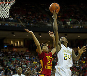Derrick Smith (24) of Dallas Madison drives to the basket against Houston Yates during the UIL 3A state championship game at the Frank Erwin Center in Austin on Saturday, March 9, 2013. (Cooper Neill/The Dallas Morning News)