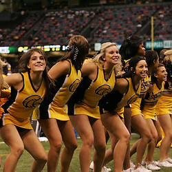 21 December 2008:  A Southern Miss cheerleaders performs during a 30-27 overtime victory by the Southern Mississippi Golden Eagles over the Troy Trojans in the  R+L Carriers New Orleans Bowl at the New Orleans Superdome in New Orleans, LA.