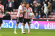 Sheffield United forward Billy Sharp (10)  who scored a hat trick celebrates at the end of the match with Sheffield United defender Richard Stearman (19) during the EFL Sky Bet Championship match between Sheffield United and Wigan Athletic at Bramall Lane, Sheffield, England on 27 October 2018.