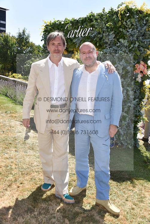 Marc Newhouse and Sir Jonathan Ive at the 'Cartier Style et Luxe' enclosure during the Goodwood Festival of Speed, Goodwood House, West Sussex, England. 15 July 2018.