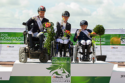 Podium Freestyle Grade II Para Dressage 1. Rixt van der Horst and Uniek, 2. Caroline Cecilie Nielsen and Leon, 3. Demi Vermeulen and Vaness - Alltech FEI World Equestrian Games™ 2014 - Normandy, France.<br /> © Hippo Foto Team - Leanjo de Koster<br /> 25/06/14