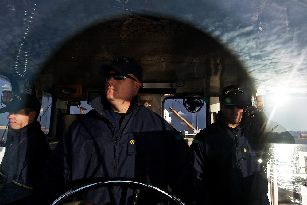 Executive Petty Officer Jeff Ritter, center, Senior Chief Brian Kuhar, right, and a crew with the U.S. Coast Guard patrols the Potomac River as a part of security measures taken for the Presidential Inauguration ceremonies in Washington, D.C., on January 21, 2013.
