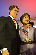 Texas Governor Rick Perry with former First Lady Laura Bus at the Texas Medal of Arts Awards, Austin Texas, April 7, 2009. The Texas Medal of Arts Awards is a celebration by the Texas Cultural Trust of the finest in Texas artists.