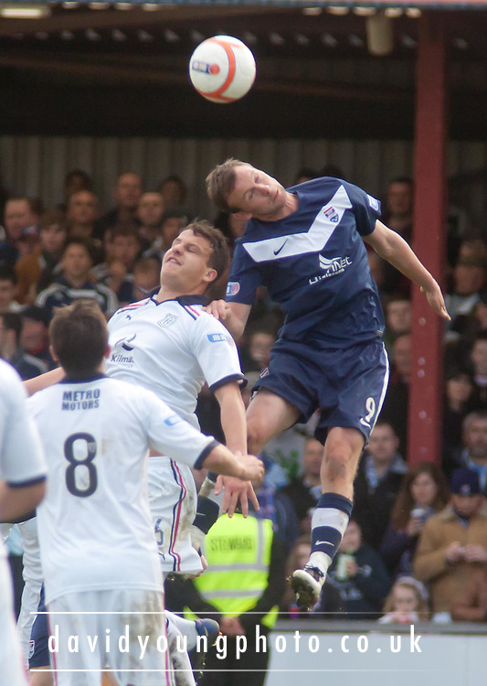 Ross County's Colin McMenamin wins an aerial challenge with Dundee's Kyle Benedictus - Ross County v Dundee, Irn Bru Scottish Football League First Division at Victoria Park..© David Young - 5 Foundry Place - Monifieth - DD5 4BB - Telephone 07765 252616 - email: davidyoungphoto@gmail.com - web: www.davidyoungphoto.co.uk