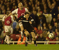 Photo. Greig Cowie<br />Arsenal v Roma. UEFA Champions League. 11/03/2003<br />Pascal Cygan challenges Francesco Totti before the Italian is sent off