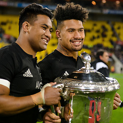 Julian Savea (L) and Ardie Savea (R) pose with the Bledisloe Cup after winning the Investec Rugby Championship match between the New Zealand All Blacks and the Australia Wallabies at Westpac Stadium in Wellington, New Zealand on Saturday, 27 August 2016. Photo: Marco Keller / www.lintottphoto.co.nz