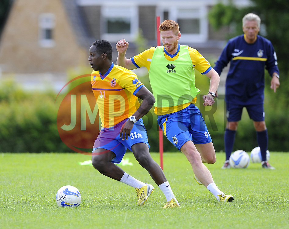 Bristol Rovers' Shaquille Hunter battles for the ball with Bristol Rovers' Matt Harrold - Photo mandatory by-line: Joe Meredith/JMP - Tel: Mobile: 07966 386802 24/06/2013 - SPORT - FOOTBALL - Bristol -  Bristol Rovers - Pre Season Training - Npower League Two