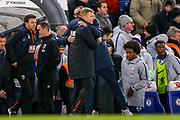 Chelsea Manager Mourizio Sarri embraces AFC Bournemouth manager Eddie Howe at the end of the game during the quarter final of the EFL Cup match between Chelsea and Bournemouth at Stamford Bridge, London, England on 19 December 2018.