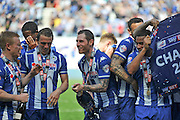 Wigan Team mates celebrate after winning the League One Trophy