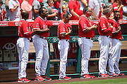 ANAHEIM, CA - JULY 20:  Batting coach Don Baylor (second from left) #25 of the Los Angeles Angels of Anaheim and fellow coaches stand during the playing of the National Anthem before the game against the Seattle Mariners at Angel Stadium on Sunday, July 20, 2014 in Anaheim, California. The Angels won the game 6-5. (Photo by Paul Spinelli/MLB Photos via Getty Images) *** Local Caption *** Don Baylor