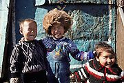 These happy young neighbors of the Regzen Batsuuri family live in a 200 square foot ger (round tent built from canvas, strong poles, and wool felt) on a hillside lot overlooking one of the sprawling valleys that make up Ulaanbaatar, Mongolia. Children, Child. The Regzen Batsuuri family lives in a 200 square foot ger (round tent built from canvas, strong poles, and wool felt) on a hillside lot overlooking one of the sprawling valleys that make up Ulaanbaatar, Mongolia. Material World Project.