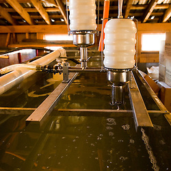 Vaccuum system above a sap tank in a sugar house in South Woodstock, Vermont.  Kendron Sugar Makers.