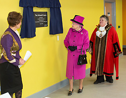 SLOUGH-ENGLAND-5-APR-2013: Britain's HM Queen Elizabeth and HRH The Duke of Edinburgh visit the Britwell Centre where they viewed the facilities, including the Community Hall, the Kitchen and Main Library. The Royal Party will met local groups who will use the new Community Centre. To mark the visit The Queen unveiled a plaque..Photograph by Ian Jones