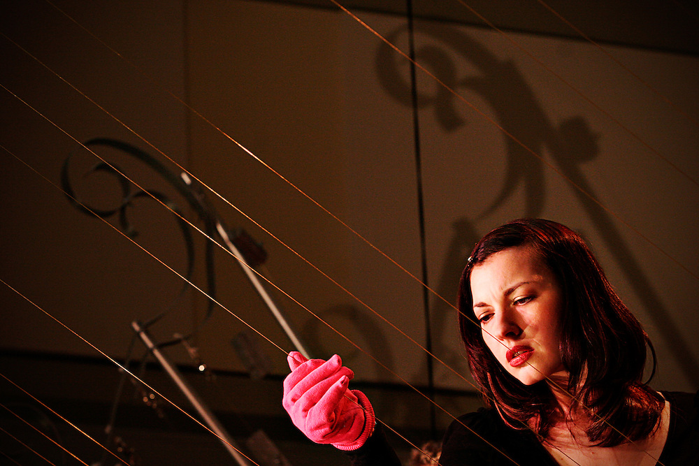 """The MASS Ensemble presents it's feature performance Feb. 11, 2007 in the Baker Center, Ohio University, Athens, Ohio. MASS (Music, Architecture, Sonic, Sculpture), is an internationally renowned musical performance group. Utilizing the Earth Harp, """"The World's Largest STringed Instrument,"""" the center's atrium was transformed into an instrument as the audience participated throughout."""