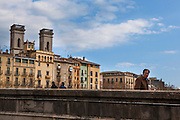 A man crosses over the the river Onyar, in Girona, Catalonia, Spain