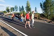 Lieske Yntema loopt terug met het team na afloop van haar eerste recordpoging. Het Human Power Team Delft en Amsterdam (HPT), dat bestaat uit studenten van de TU Delft en de VU Amsterdam, is in Senftenberg voor een poging het laagland sprintrecord te verbreken op de Dekrabaan. In september wil het HPT daarna een poging doen het wereldrecord snelfietsen te verbreken, dat nu op 133 km/h staat tijdens de World Human Powered Speed Challenge.<br /> <br /> Lieske Yntema walks back with the team after her first record attempt. With the special recumbent bike the Human Power Team Delft and Amsterdam, consisting of students of the TU Delft and the VU Amsterdam, is in Senftenberg (Germany) for the attempt to set a new lowland sprint record on a bicycle. They also wants to set a new world record cycling in September at the World Human Powered Speed Challenge. The current speed record is 133 km/h.