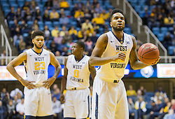 Dec 5, 2015; Morgantown, WV, USA; West Virginia Mountaineers guard Tarik Phillip (12) shoots a foul shot during the second half against the Kennesaw State Owls at WVU Coliseum. Mandatory Credit: Ben Queen-USA TODAY Sports