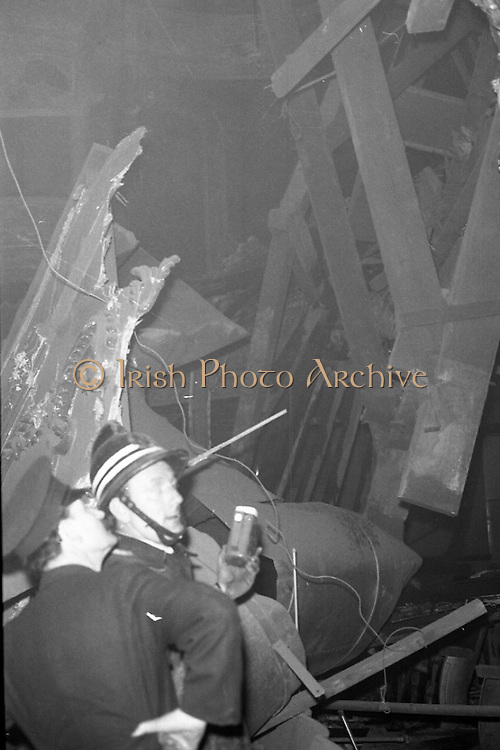 Stage at The Olympia Theatre Collapses..05.11.1974..11.05 1974..5th November 1974..At the lunch-time break during rehearsals for the musical West Side Story the front section of the Olympia stage collapsed. Fire brigades rushed to the scene in case of casualties. The theatre will remain closed until further notice until structural examinations of the building are carried out by the relevant authorities..Picture shows fire officers searching through the wreckage in the aftermath of the stage collapse.