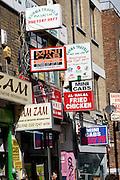 Signs travel agents, mini cabs, food, Brick Lane London