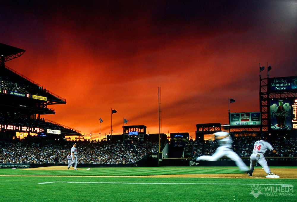 Todd Hollandsworth of the Colorado Rockies races to first base to beat the throw in a game against the Atlanta Braves at Coors Field in Denver, CO. ©Brett Wilhelm/Rich Clarkson and Associates, LLC