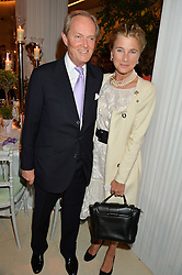 The MARQUESS & MARCHIONESS OF DOURO at a dinner hosted by Cartier in celebration of The Chelsea Flower Show held at The Hurlingham Club, London on 19th May 2014.