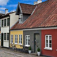 Colorful Houses on Bangs Boder in Odense, Denmark <br /> Most visitors to Odense rush to see the one bedroom house where Hans Christian Anderson was born.  But in their haste, they often fail to appreciate the surrounding row houses along the cobblestone streets like these on Bangs Boder. This is the Old Quarter of the city.  These colorful homes appear much like they did when the famous fairy-tale author was born in 1805.