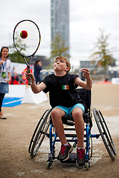 © Licensed to London News Pictures. 03/09/2016. LONDON, UK. Benjamin Cochran plays paralympics tennis with a wheelchair to experience the disability sports at National Paralympic Day and Liberty Festival in Queen Elizabeth Olympic Park in London on Saturday 3 Spetember 2016. Photo credit : Tolga Akmen/LNP