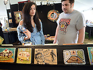 DOYLESTOWN, PA - MAY 17:  Jen Branch (L), 24, and Tom Laskey, 25 of Jamison, Pennsylvania look at tiles at the Tile Festival at Moravian Pottery and Tile Works May 17, 2014 in Doylestown, Pennsylvania. The festival is a two-day show and sale of handcrafted contemporary and historic decorative tiles and mosaics by tile artisans and vendors. (Photo by William Thomas Cain/Cain Images)