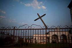 A wooden cross is posted to a fence next to the tracks in Tenosique, Tabasco.  Tenosique is the starting point for migrants who will travel on top of a freight train north to the border with the United States.  The trip for these migrants, mostly from Central America,  has become increasingly dangerous over the past several years as Mexico's drug war has raged and kidnappings and killings of migrants has increased.