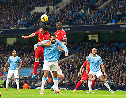 MANCHESTER, ENGLAND - Boxing Day Thursday, December 26, 2013: Liverpool's captain Luis Suarez and Mamadou Sakho in action against Manchester City's Joleon Lescott during the Premiership match at the City of Manchester Stadium. (Pic by David Rawcliffe/Propaganda)